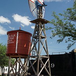 Windmill and water tower at Railroad station in Lamar, CO